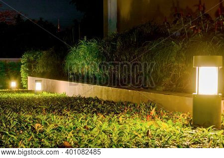 Small Garden Light, Lanterns In Flower Bed. Garden Design. Solar Powered Lamp.