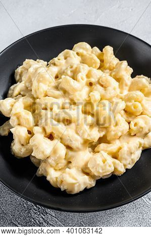 Mac And Cheese. Macaroni Pasta In Cheesy Sauce. Gray Background. Top View