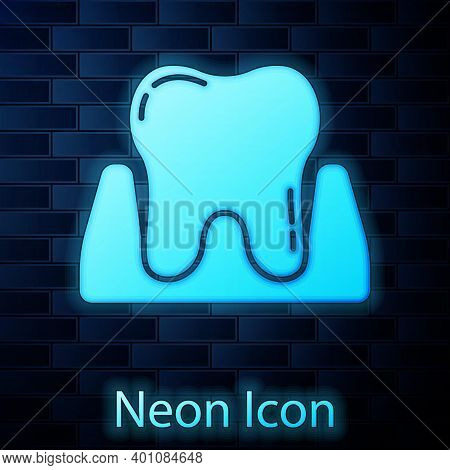 Glowing Neon Tooth Icon Isolated On Brick Wall Background. Tooth Symbol For Dentistry Clinic Or Dent