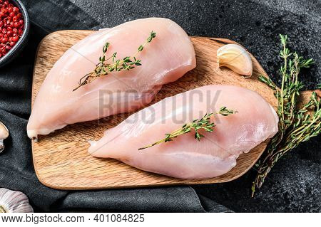 Fresh Raw Chicken Breast Fillet, Organic Meat. Black Background. Top View