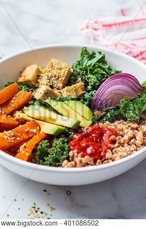Baked Vegetables, Avocado, Tofu And Buckwheat Buddha Bowl. Vegan Lunch Salad With Kale, Baked Sweet