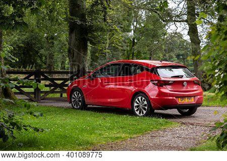 Aberdeen, Scotland - August 10, 2019: Vauxhall Opel Astra Car Parked In British Green Park  Behind T