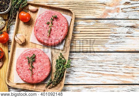 Raw Burger Patties. Mince Meat Cutlet, Ground Beef And Pork. White Background. Top View. Copy Space