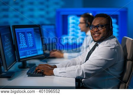 Call-center Worker Is Speaking With The Client By Headset. Workplace Of The African-american Support