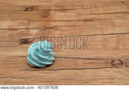 A Blue Meringue On A Wooden Table