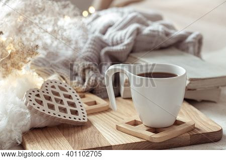 Cozy Composition With A Cup Of Coffee On A Saucer And Home Decor Details.