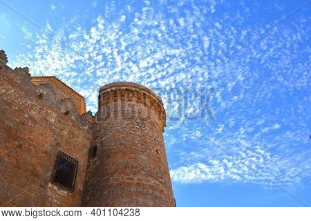 Views Of The Tower Of The Castle Of Belmonte With Intense Blue Sky With Clouds.