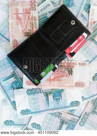 Russian Rubles Of Categories One Thousand And Five Thousand With An Open Wallet On Them.
