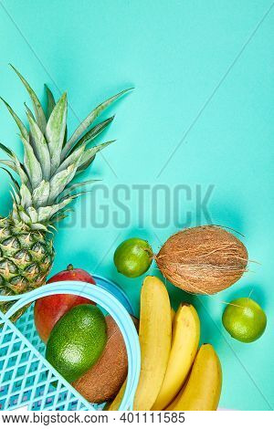 Grocery Shopping Bag With Organic Exotic Fruits On Blue Background.
