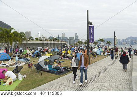Hong Kong November 28 2020 : People Wearing Protective Masks Picnicking And Camping In West Kowloon