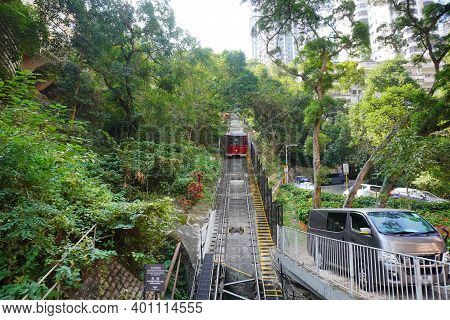 Hong Kong November 2020 : The Peak Tram Climbing Up The Steep Hill, A Funicular Railway And Landmark