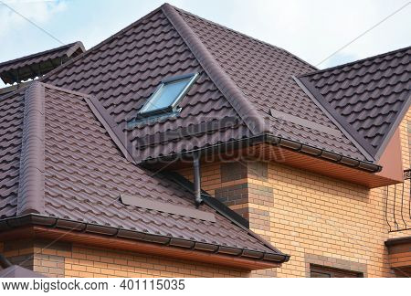 Complex Roof Design, Metal Tiled Expensive Roofing Construction With A Skylight, Snow Guards, Chimne
