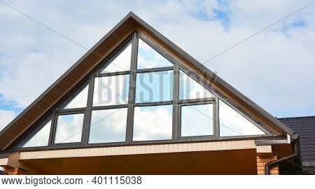 A Close-up Of A Panoramic Attic Window Of A Modern House, Triangular Attic Roof Window Design, Large