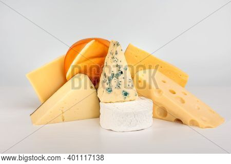 Various Types Of Cheese Isolated On Gray Background. Blue Cheese Dorblu, Smoked Suluguni, Brie, Maas