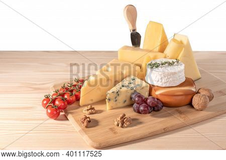 Still Life Cheese Isolated On White Background. Composition Different Types Of Cheese With Walnuts,