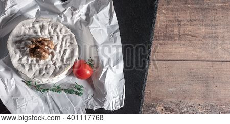 Cheese With Nuts And Tomato. Delicious Brie Cheese On Black Background. Brie Type Of Cheese. Camembe