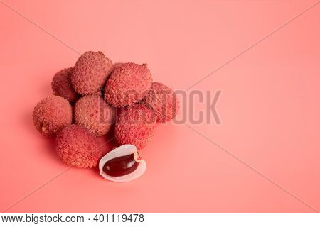 Tropical Fruits - Lychee Or Litchi On Pink Background With Copy Space. Selective Focus