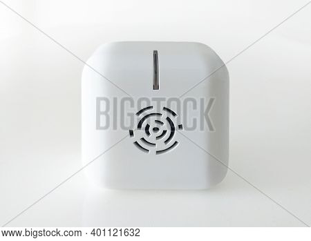 Front View Of White Indoor Anti Insect Repellent Isolated On White Background. Electronic Device To