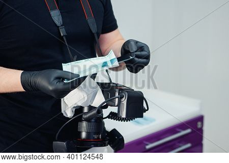 Professional Dentist Removes A Disinfected Mirror From The Package For Making Occlusal Photographs O