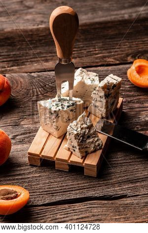 Dorblu Cheese Pieces With Peaches Fruit On A Wooden Background, Danish Blue Cheese, Food Recipe Back