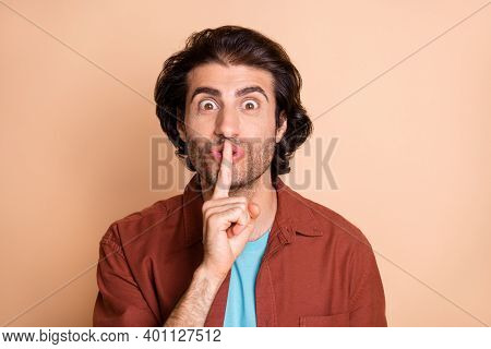 Close-up Portrait Of Nice Attractive Cheery Guy Showing Showing Shh Sign Isolated Over Beige Pastel