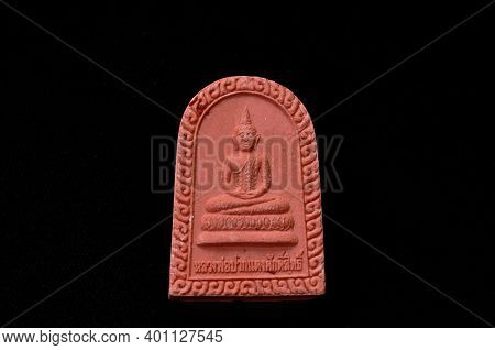 Small Buddha Image Amulet Carrying For Luck And  Remember To Do Good Thing On Black Background Forei