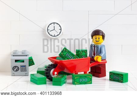 Tambov, Russian Federation - December 23, 2020 Lego Businessperson Minifigure Transporting Money In