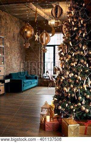 Christmas Room Interior. Stylish Interior Of Living Room With Christmas Fir Tree And Green Sofa. Bea