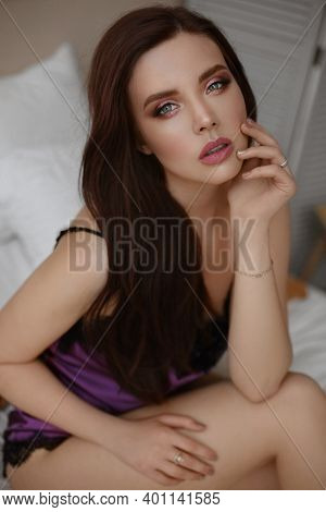 Magnificent Young Woman With Perfect Makeup And Beautiful Long Healthy Hair In Satin Underwear Posin