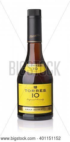 Samara, Russia - December 2020. Product shot of brandy Torres 10 Gran Reserva bottle isolated on white
