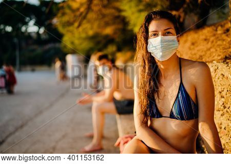 Young Woman On A Beach Wearing A Protective Mask.beach Holiday Vacation In Summer During Coronavirus