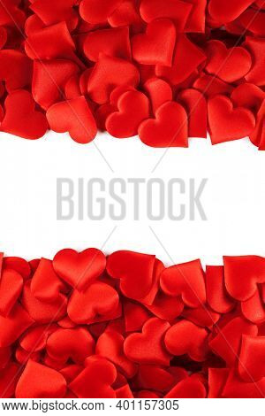 Valentine's day many red silk hearts background , border frame isolated on white with copy space, love concept