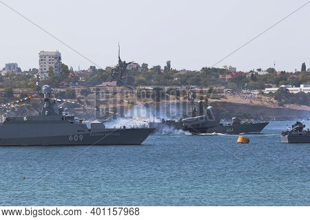Sevastopol, Crimea, Russia - July 26, 2020: Missile Boat R-334 Ivanovets Passes Next To The Small Mi