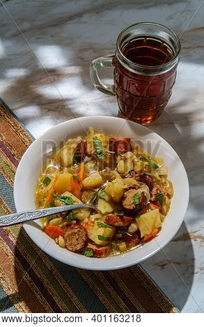 Hearty German Oktoberfest Stew With Beer Bratwurst Shredded Cabbage And Potatoes