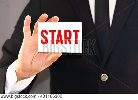 Man Showing White Card With Start Word . Business Concept