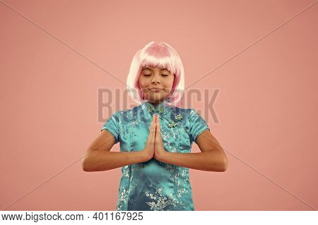 Without A Sound. Happy Child Do Meditation Holding Hands In Namaste. Meditation Or Prayer. Small Gir
