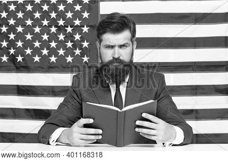 Book For Mastering American English. Bearded Man Read Book On Usa Flag Background. Reading Book. Voc