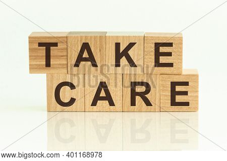 Take Care Written On A Wooden Cube. Take Care - Text On Wooden Cubes On A White Background, Concept