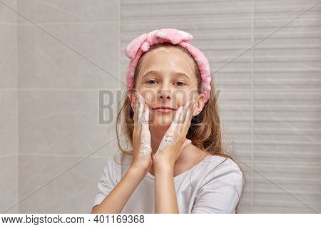 Wash Your Face With Cleansers And Foam. On The Head Is A Pink Hairband.