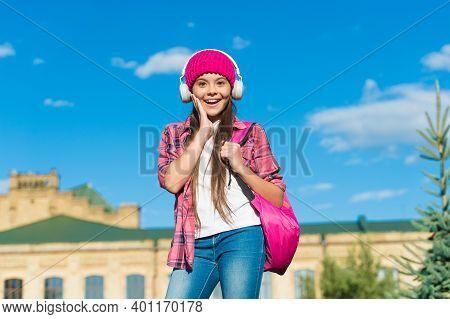 Never Stop Listening. Surprised Child Wear Headphones Outdoors. Listening Skills. Listen Technology.