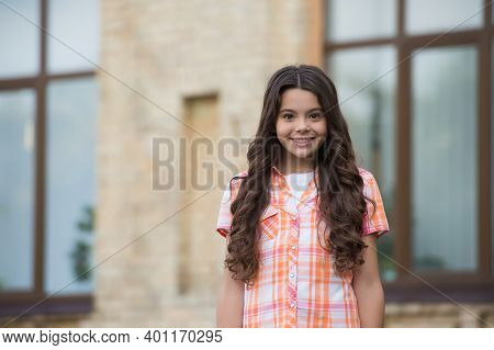 Inspire Yourself To Be Beautiful. Happy Girl With Long Wavy Hair Smile Urban Outdoors. Beauty Salon.