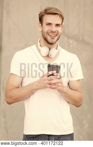 He Needs Caffeine Energy. Happy Guy Hold Takeaway Cup Outdoors. Handsome Man Drink Tea Or Coffee. En