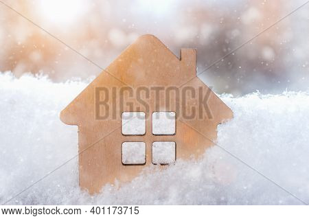 Small Wooden House Close-up In The Winter Snow. Idea - Christmas Sales, Winter Discounts On Real Est