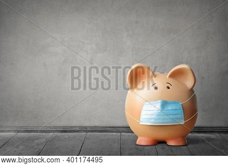 piggy bank with mask on a gray background