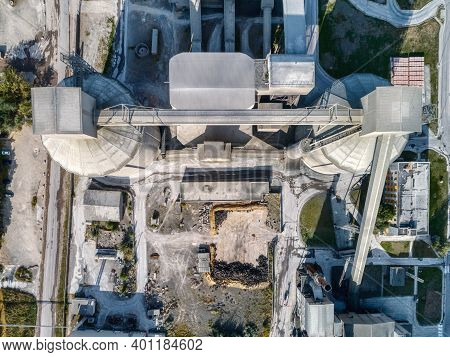 Cement Plant, Aerial View. View Vertically From Top To Bottom. Large Vertical Silos.
