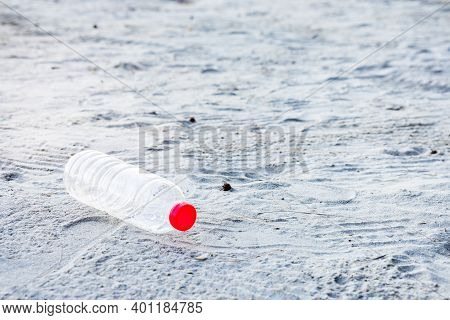 Plastic Bottle On Beach, It's Pollutes To The Nature In Sea And The Life Of Marine. Concept Of Envir