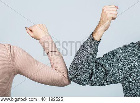 Two People Bump Elbows To Avoid Coronavirus. Coronavirus Epidemic. Elbows Bump. Health Care Concept.