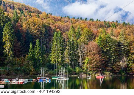 Bohinj is an alpine lake of glacial origin in the Julian Alps. Magnificent lake with clear water. Sailing yachts and motor boats are moored to the shore