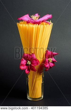 Spaghetti - Yellow Pasta, Italian Dishes And Cuisine, Spaghetti In A Glass And A Decorative Flower.