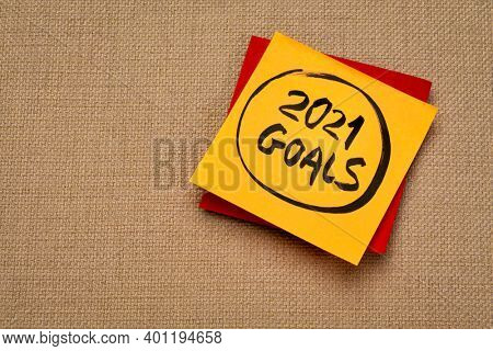 2021 goals reminder  - handwriting on a sticky note, New Year resolutions and goal setting concept